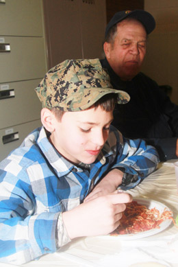 Ben Winter of Sandown digs into a plate of spaghetti at the Harvest Pasta Feed hosted by the Sandown Lions at the Town Hall.