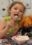 Pictured, 3-year-old Emma Hickey digs into her delicious treat