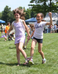 Pictured, Jessica Dane and Sophia Phaneuf race to the finish line in the three-legged race.