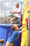 Jakobi Sanseverino takes a run at the switch to dunk Richard Buco during the annual Old Home Day celebration in Sandown.