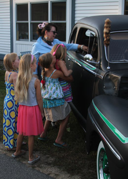 JoAnn Evans was busy showing off her husband's 1947 Ford to students.