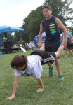 Pictured, Chris Perfetto and David Hammond take first place in the wheel barrow race held on the fair grounds.