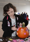 Pictured, Aaliyah Fanion of Sandown decorates a pumpkin. Photo by Chris Paul.