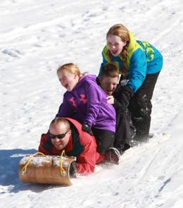 The Stinson family took advantage of ideal sledding conditions on Saturday afternoon in Chester. Photo by Chris Paul