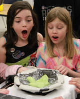 Sandown Central School students Mikayla Cole, left, and Adrienne Guerette watch a sound experiment performed during the school's final day of a Scientist in Residence program. Photo by Chris Paul