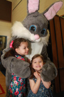 Ava and Lea Michelinie receive a big hug from the Easter Bunny during Saturday's Easter Pancake Breakfast at Hampstead Central School. Photo by Chris Paul