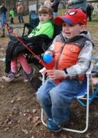 Jimmy Daley thinks he's hooked a big one as his sister, Lilly Daley, looks on at the annual Sandown Fishing Derby, hosted by the Sandown Conservation Commission at Sal's Pond. Photo by Chris Paul
