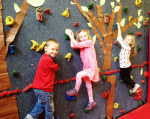 First graders use the climbing wall as if they were butterflies as one of the Butterfly Show pieces. Courtesy photo