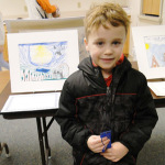 "Caden Morse, 5, a kindergarten student at Hampstead Central School, won a blue ribbon for his Reflections submission, ""Clean Up."" It will go to state judging in March. Photo by Penny Williams"
