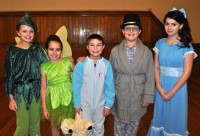 """From left are Alyssa Beaulieu of Londonderry as Peter Pan, Isabella Charlebois of Hampstead as Tinker Bell, Logan Young of Sandown as Michael Darling, Frank Thomas of Londonderry as John Darling, and Ruthie Vinson of Derry as Wendy Darling in the Kids Coop production of """"Peter Pan."""" Courtesy Photo."""