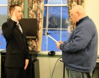 "Board of Selectmen Chairman Sean Murphy swears in Hampstead's newest full-time Police Officer, Alan ""Scott"" Randell. Photo by Penny Williams"