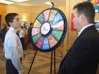 Charles Lavoie, an eighth-grader from Chester, learns his prize - or penalty - from Richard Arkand of the New Hampshire Banking Association in the CU4 Reality Fair at Pinkerton Academy. Photo by Kathleen D. Bailey